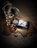 291 SL-1-71-Still life product photographer Dennis Pedersen advertising editorial Creative drink alcohol booze ice glass spill liquid whiskey phone mobile blackberry smash crack wood glow moody
