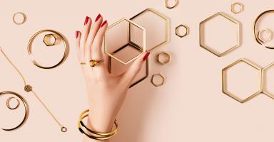 Still life product photographer dennis pedersen beauty cosmetic makeup fashion style jewel jewellery gold ring bracelet bangle cuff graphic shape hand model nails